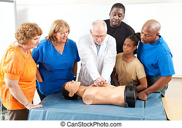 First Aid Training for Adults - Doctor demonstrates CPR for...