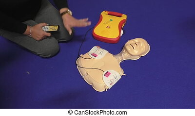 Health service training instructor demonstrating cardiopulmonary resuscitation or CPR training kit