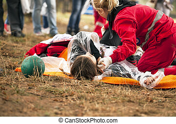 Paramedic gives first aid to the accident victim