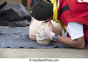 First aid training - CPR practitioner examining airways on...