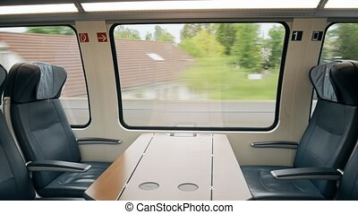 First class compartment in a moving high speed train - First...