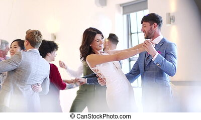 First Dance At Our Wedding - Newly wed couple are dancing...