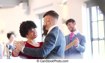 First Dance At The Wedding - Couples are dancing together at...