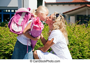 First day at school - Mother taking her daughter to school,...