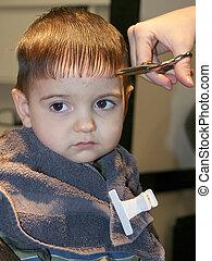First Hair Cut 03 - Small boy getting his first hair cut. ...