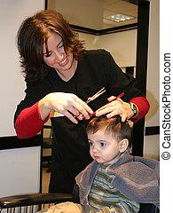 First Hair Cut 05 - Small boy getting his first hair cut. ...