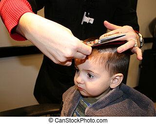 First Hair Cut - Small boy getting his first hair cut. Main...