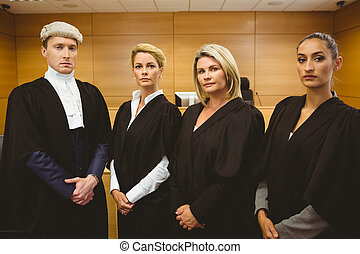 First judge standing while wearing