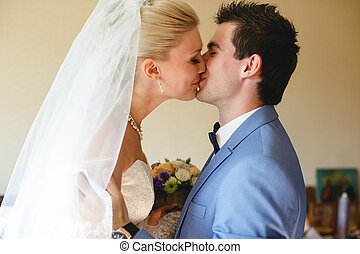 First kiss of the couple in the wedding day