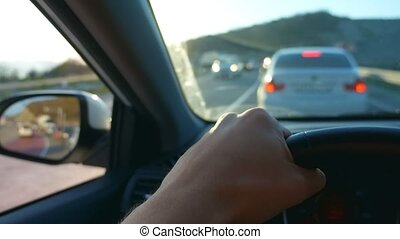 first-person view. Driving a car in rush hour - Driving a...