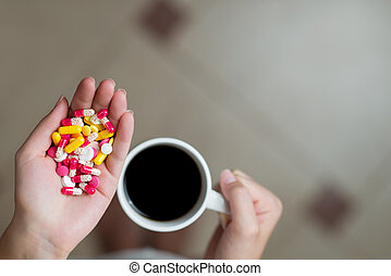 first-person view of coffee and pills