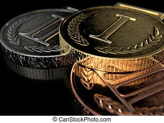 First Second And Third Medals - A closeup set of gold, ...