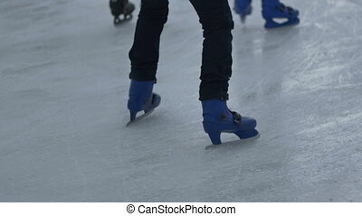 First Steps on Ice Skate - Teen is making hesitateting steps...