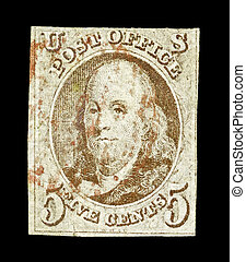 UNITED STATES of AMERICA - CIRCA 1847: A rare first stamp of the United States of America which honors Benjamin Franklin, the first Postmaster General of the United States, circa 1847.