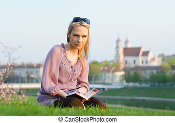 Young sexy woman reading