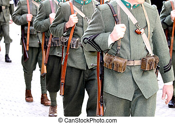 first World War soldiers with their rifles during a military parade in the city