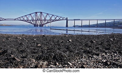 Firth of Forth Bridge in Scotland - Train crossing the irth...