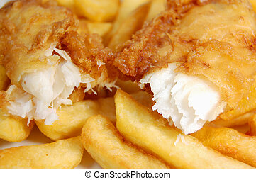 Fish and chips - Closeup of a piece of cod broken into two ...