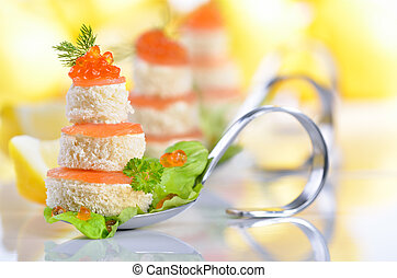 Tidbits with smoked salmon, caviar, cream cheese and toast on party spoons