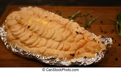 fish baked in salt mousse - fire burns on crust made from...