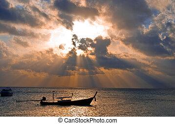 Fish boat at sunrise