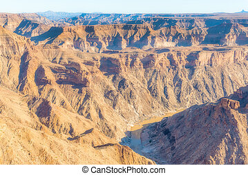 The Fish River Canyon is located in the south of Namibia. It is the largest canyon in Africa. It features a gigantic ravine, in total about 160 km long, up to 27 km wide and in places almost 550 meters deep.