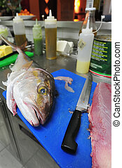 fish chopping board restaurant kitchen