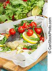 Fish - Cod with lemon slices and vegetables wrapped in ...