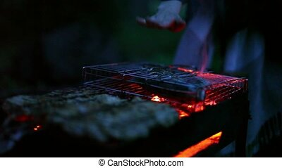 Fish cooking on grill