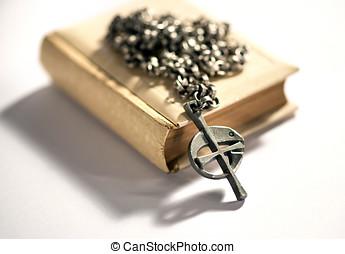 Fish cross rosary lying on a Bible