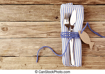 Fish Cutlery Tied on Purple Table Napkin with Tag