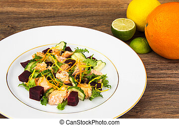 Fish dishes, salad with salmon and beets