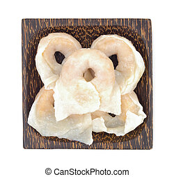 Fish dumplings in wooden dish on white background.