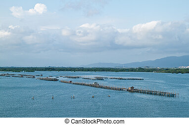Fish farm in the sea before sunset, countryside Thailand