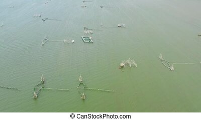 Sea fish farm. Cages for fish farming seabass with Beautiful nature scenic landscape view. Mindanao, Philippines.
