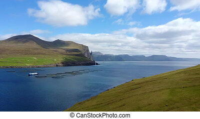 Fish farms in Faroe Islands fjord, top view - Flying over ...