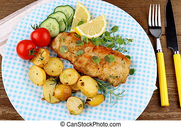 Fish fillet with rosemary potatoes, vegetables