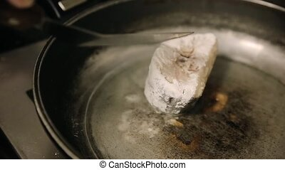 Fish fried in a pan