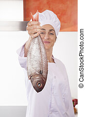 fish in happy woman chef hand