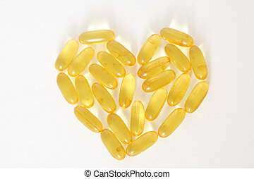 Fish oil capsules forming a shape of heart