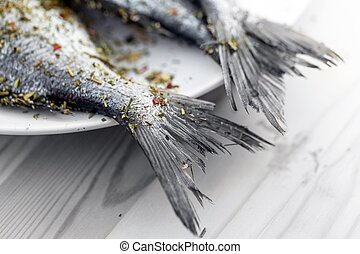 Fish on wooden background