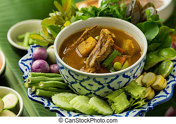 Fish organs spicy soup with bamboo shoots and vegetables