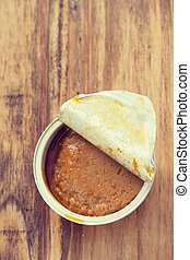 fish pate on brown wooden background