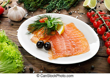 Fish - salted salmon sliced on a plate