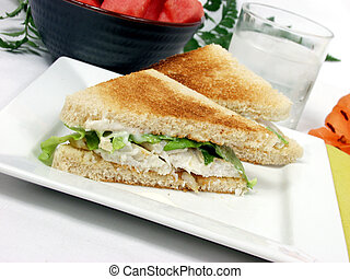 exclusive fish fillet sandwich on square platter with decoration