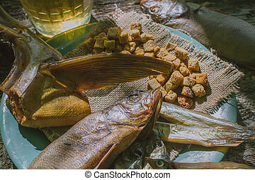 fish snacks to beer on wooden background