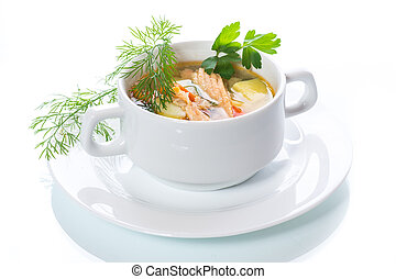 fish soup with vegetables in a plate