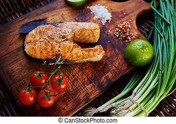 Fish steak on a wooden board - Ð¡ook restaurant ...