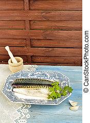 fish tray with parsley and garlic