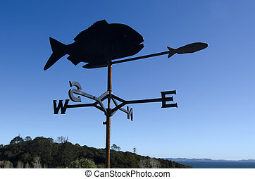 Fish weather vane - Silhouette of a fish weather vane on a ...